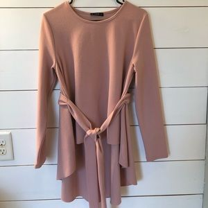 Long sleeve blouse. Color is a blush pink